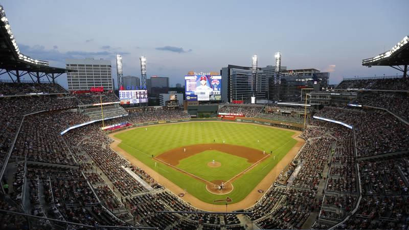 The sun sets at SunTrust park during a baseball game against the Philadelphia Phillies,...
