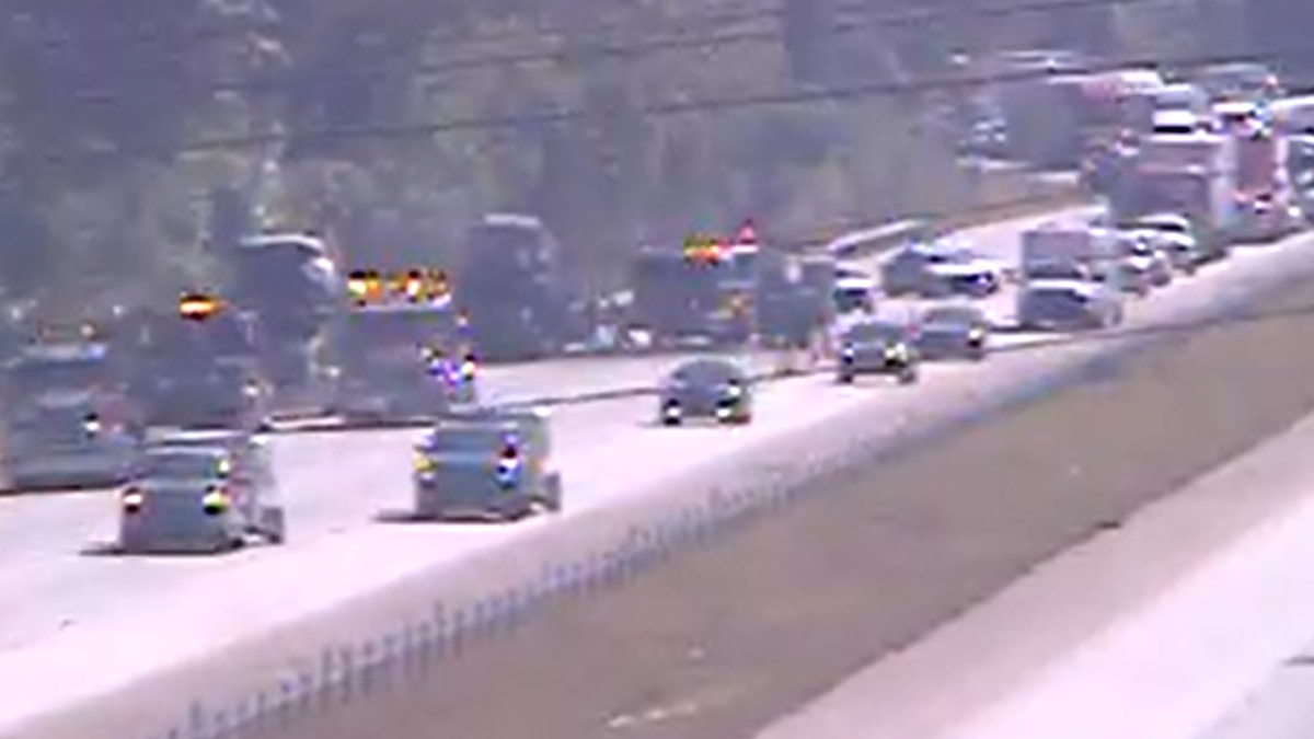 Traffic is slowed near mile marker 162 on I-95 after a tractor-trailer caught fire, officials...