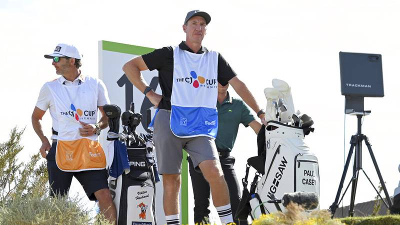 John McLaren, center, caddie for Paul Casey, looks on at the 16th tee box during the final...