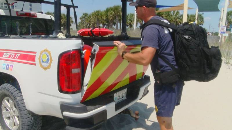 An ocean rescue crew member gets ready for patrol.
