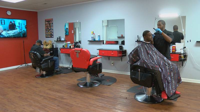 Power Cutz Barber Shop owner Corey Reaves said business was dead on Monday as closures increase...