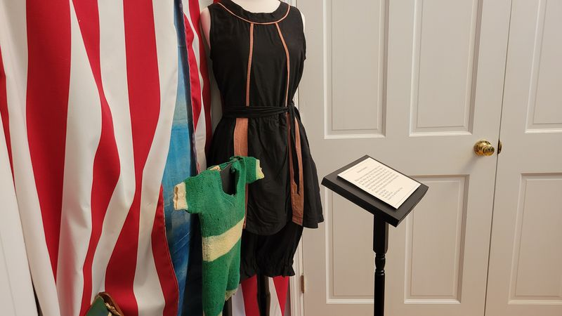 A hallway at the Marion County Museum features clothing from various historical periods.