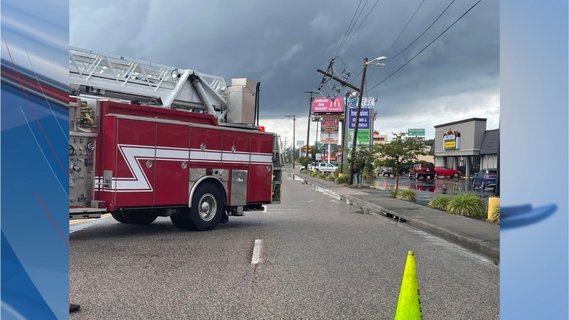 Horry County Fire Rescue crews respond to a broken utility pole along Waccamaw Boulevard in the...
