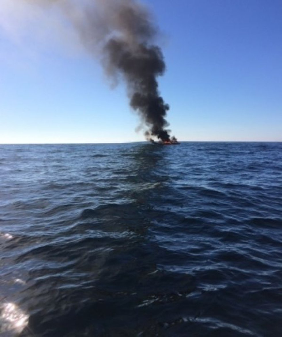 One of the four people onboard made the initial report and it was received by watchstanders at...