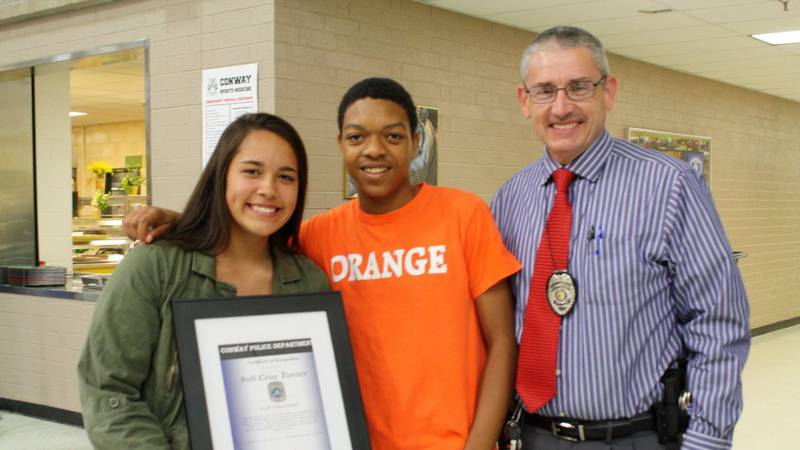 Sofi Turner and Jahiem accepted a Good Citizen Award from Conway Police for Sofi's viral act of...