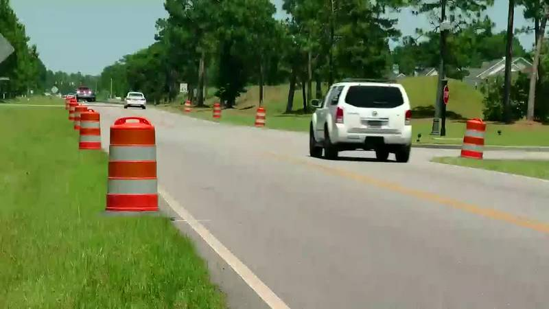 Carolina Forest Boulevard has been lined with traffic barrels for two years as the county works...