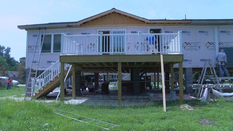 Volunteers with Samaritan's Purse help raise and repair homes damaged by flooding in the...