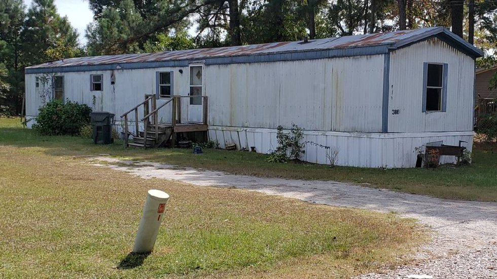 Deputies say the owner had to be tasered inside his burning home.