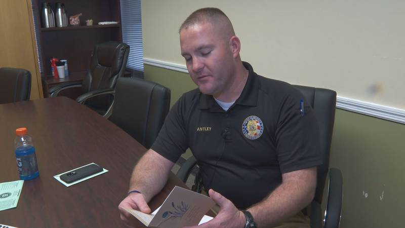 Sgt. Evan Antley reads a card sent to the Cayce Department of Public Safety.