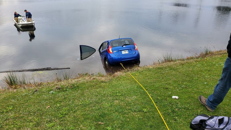 The woman's car partially submerged in the pond in front of the Wild Wing Plantation clubhouse....