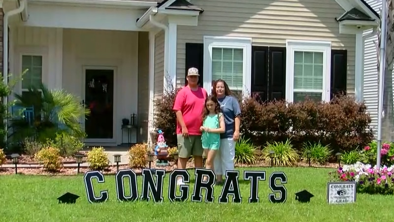 The Whitmore family celebrating Senior Austin's graduation moment. They've placed 'Congrats'...