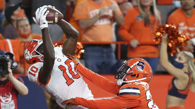 Clemson wide receiver Joseph Ngata (10) makes a touchdown catch while defended by Syracuse...