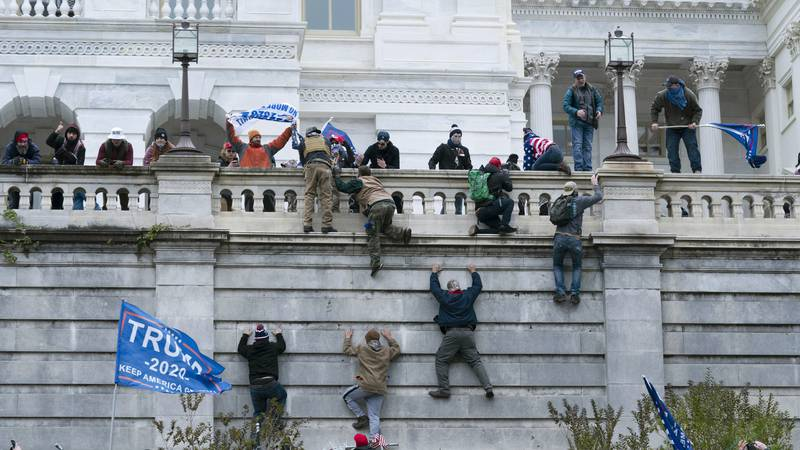 FILE - In this Jan. 6, 2021 file photo, violent insurrectionists loyal to President Donald...