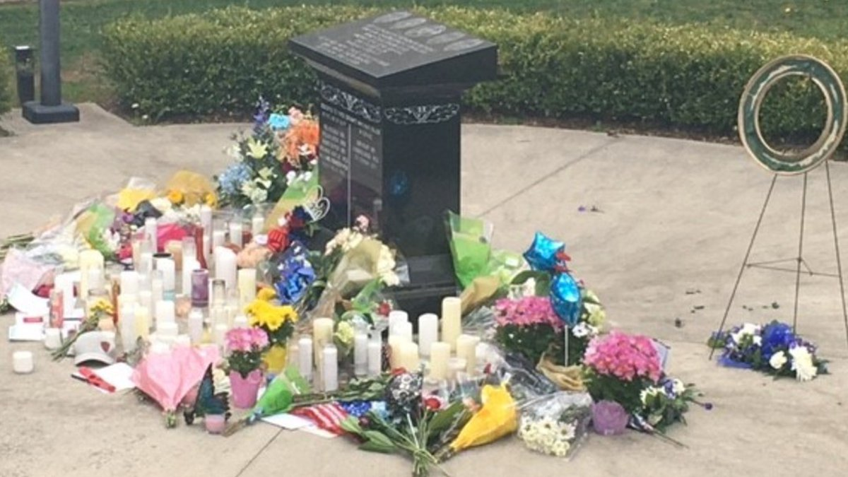 Dozens of candles and flowers were placed outside the sheriff's office.