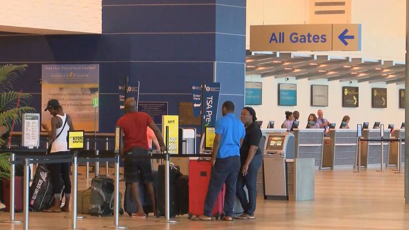 Travelers prepare to board their planes in Myrtle Beach, SC prior to COVID-19 impacting much of...