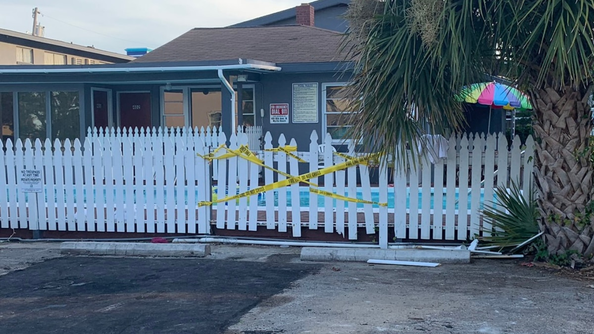 Crime scene tape ropes off a Myrtle Beach motel pool where a man drowned Wednesday night