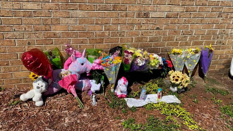 A small memorial is outside the Coastal Community Church where Angelina Pacheco's body was found.