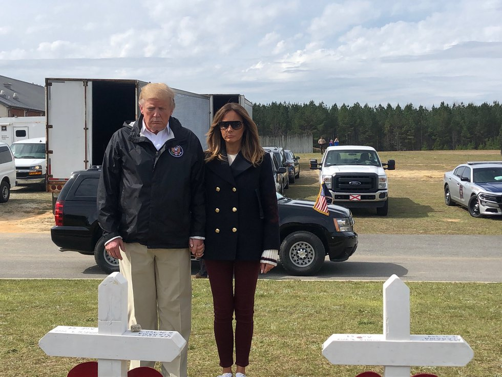 President Donald Trump and First Lady Melania Trump viewing the 23 crosses representing the 23...