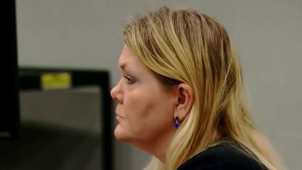 Tammy Moorer sits at the defense table Wednesday and listens during witness testimony. (Source:...