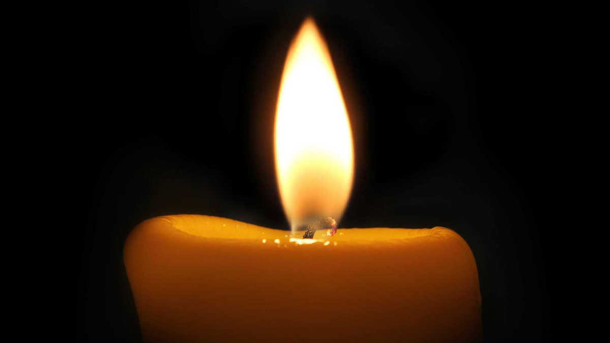 Candle in Dark Room.