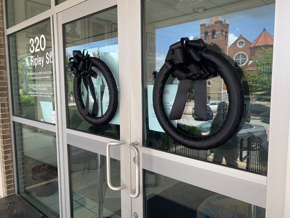 Black wreaths displayed at the entrance to MPD headquarters as officers mourn the loss of Det....