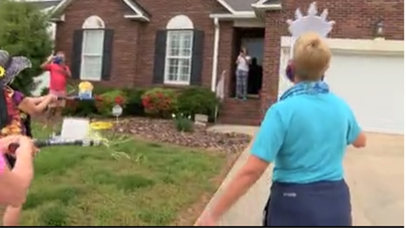 The group of women gathered on the front yard so they could sing happy birthday to 83-year-old...