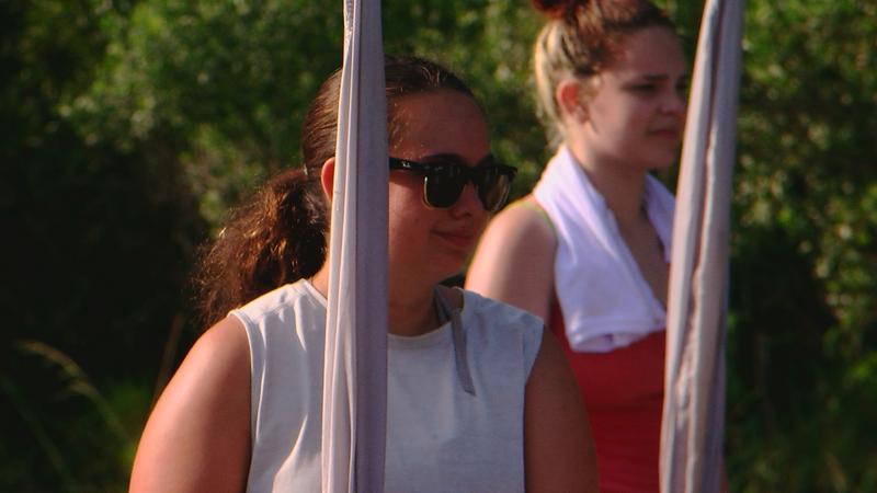 London Hansen, freshman, listens to instructors at band camp.