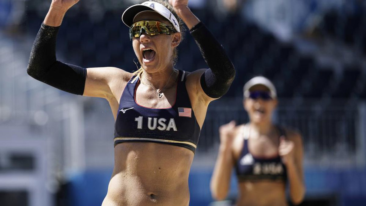 April Ross, left, of the United States, and teammate Alix Klineman celebrate winning a women's...