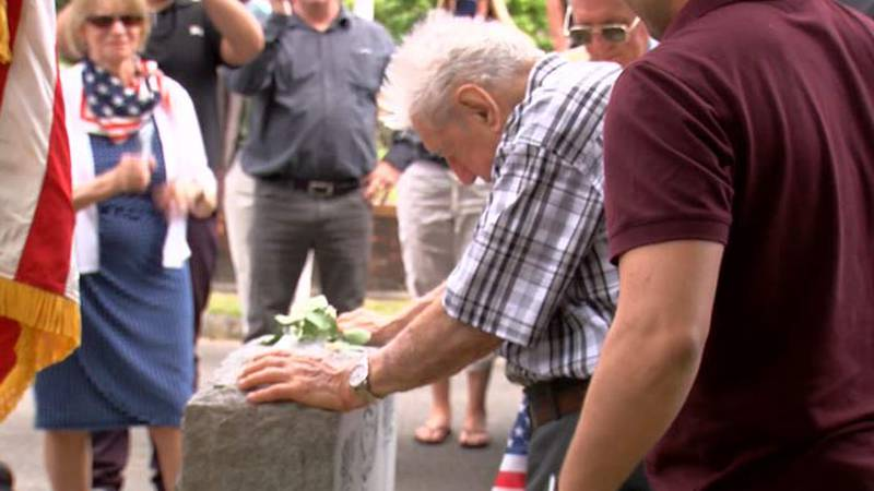 WWII veteran Anthony Grasso placed a white rose on the grave of Lt. Frank DuBose, who was...