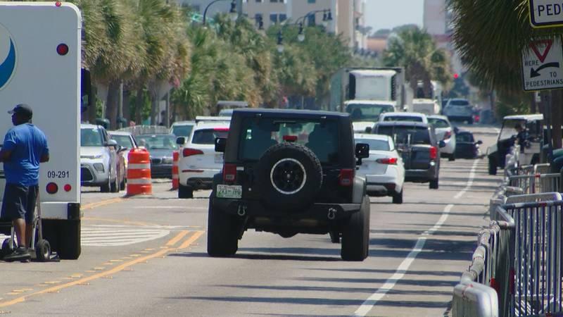 Cars drive down Ocean Boulevard in Downtown Myrtle Beach