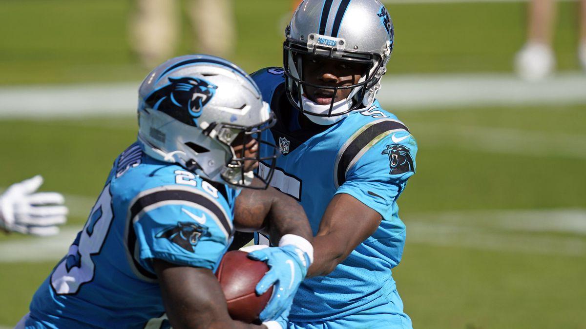 Carolina Panthers quarterback Teddy Bridgewater hands off to running back Mike Davis (28)...