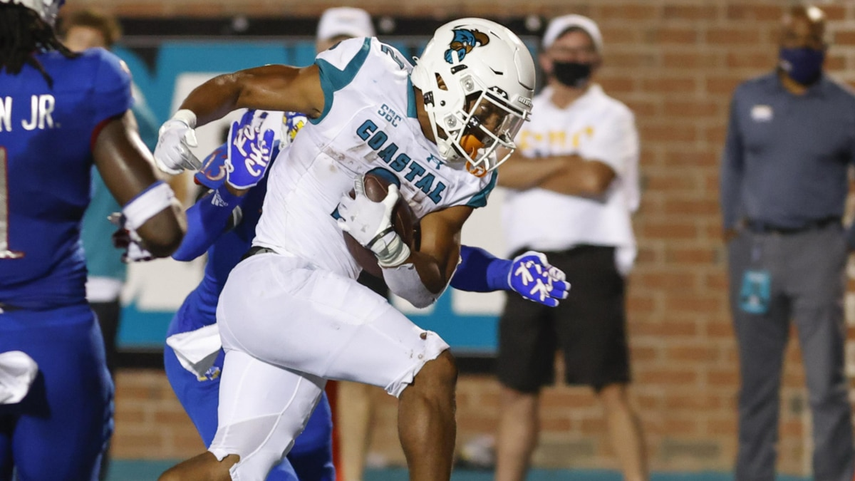 Coastal Carolina running back Reese White runs for a touchdown against Kansas during the second...