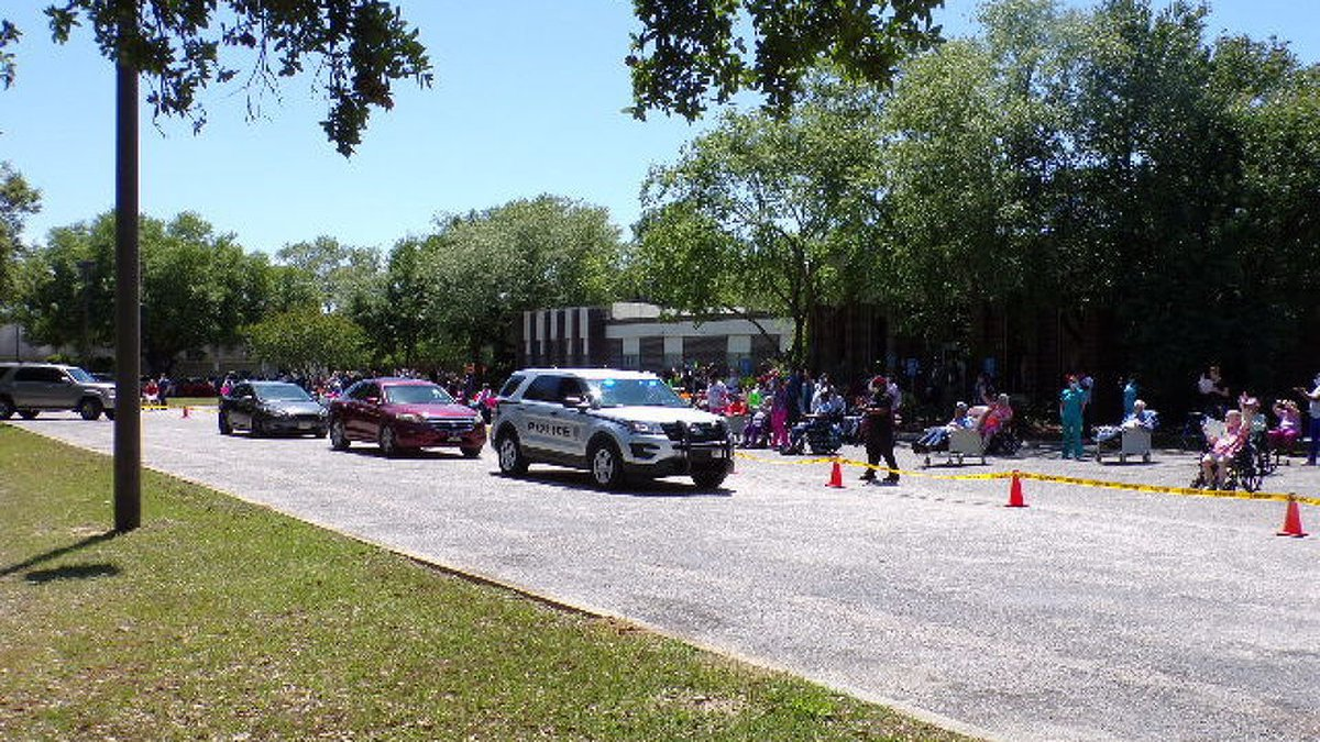 More than 70 residents lined up outside of the nursing home on Tuesday with their signs,...