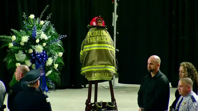 Jackson Winkeler's firefighter gear on display during his funeral.