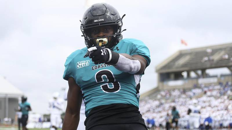 Coastal Carolina wide receiver Aaron Bedgood (3) celebrates a touchdown during the first half...