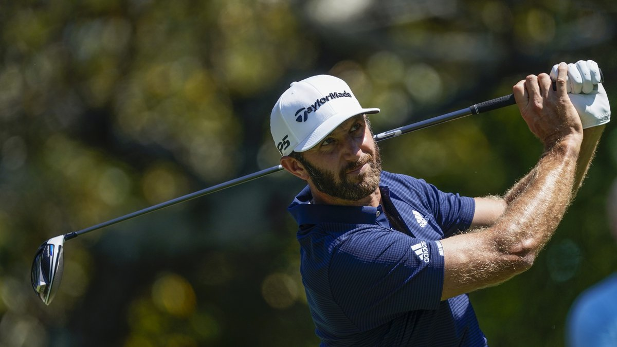 Dustin Johnson hits his tee shot on the fifth hole during the final round of the Tour...
