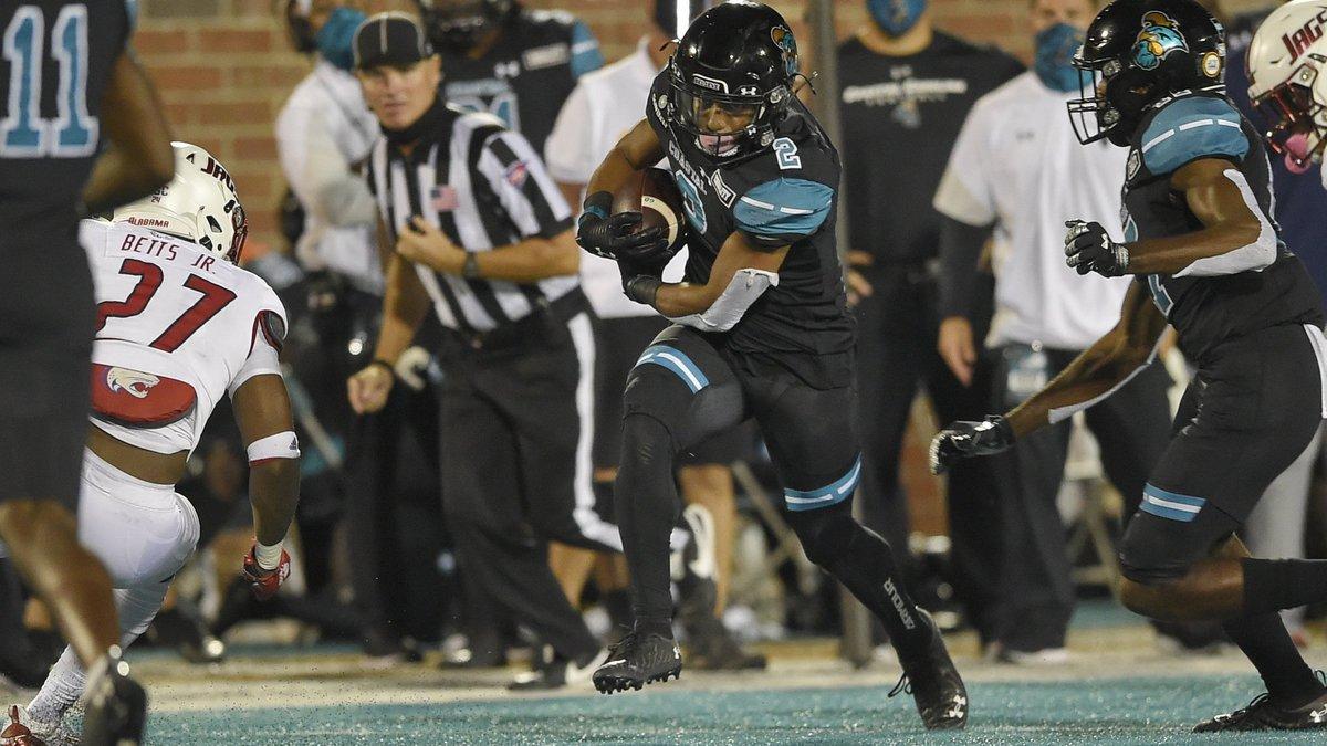 Coastal Carolina's Reese White (2) rushes while defended by South Alabama's Dewayne Betts Jr....