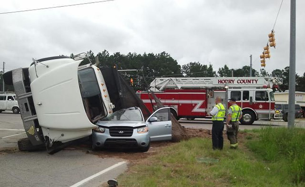 Dump truck flipped on side at Hwy 544 and Dick Pond Rd. intersection (Source: WMBF News Photog...