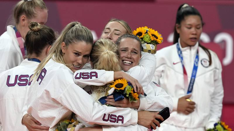 Players from the United States react after winning the gold medal in women's volleyball at the...