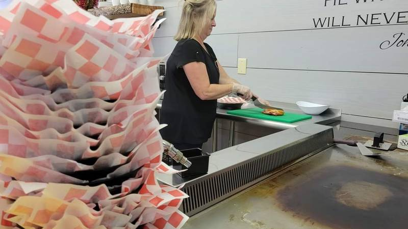 Restaurant owner makes sandwich at Ole Fashioned Sandwich Shoppe in Mullins, S.C.