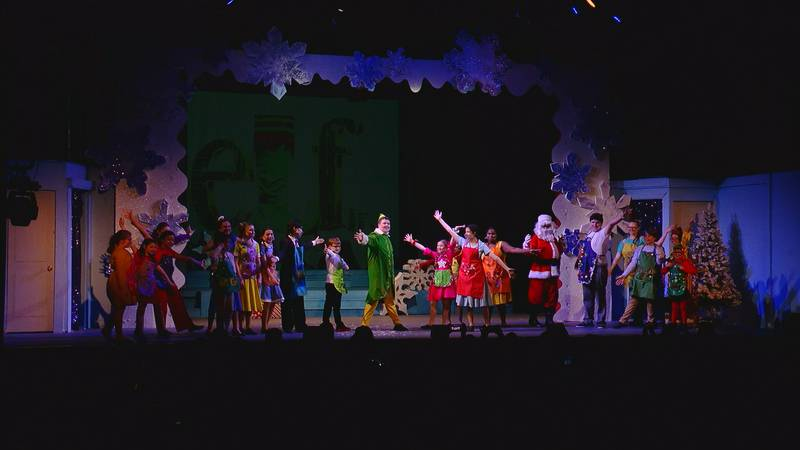 Elf Jr. actors finish the last song of the production with smiles and enthusiasm.