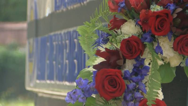 Flowers set outside in Oct. 2020 for Officer Jacob Hancher at Ted C. Collins Law Enforcement...