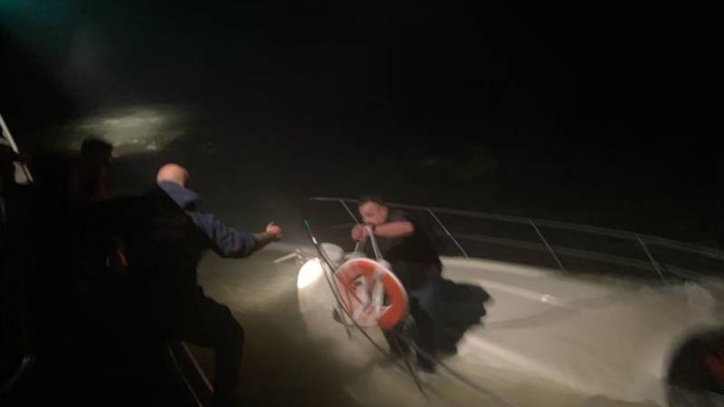 Coast Guard crews rescued two people after their 40-foot vessel capsized outside of the North...