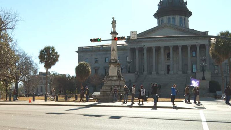Law enforcement kept a close watch on protesters, approximately 20 in number, who came to the...