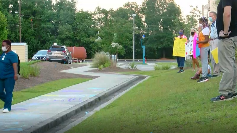Members of the Georgetown Church of Christ lined the employee entrance side walk at Tidelands...