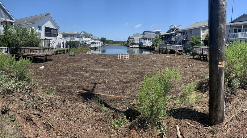 A canal full of debris on Duffy Street in the Cherry Grove neighborhood the morning after...