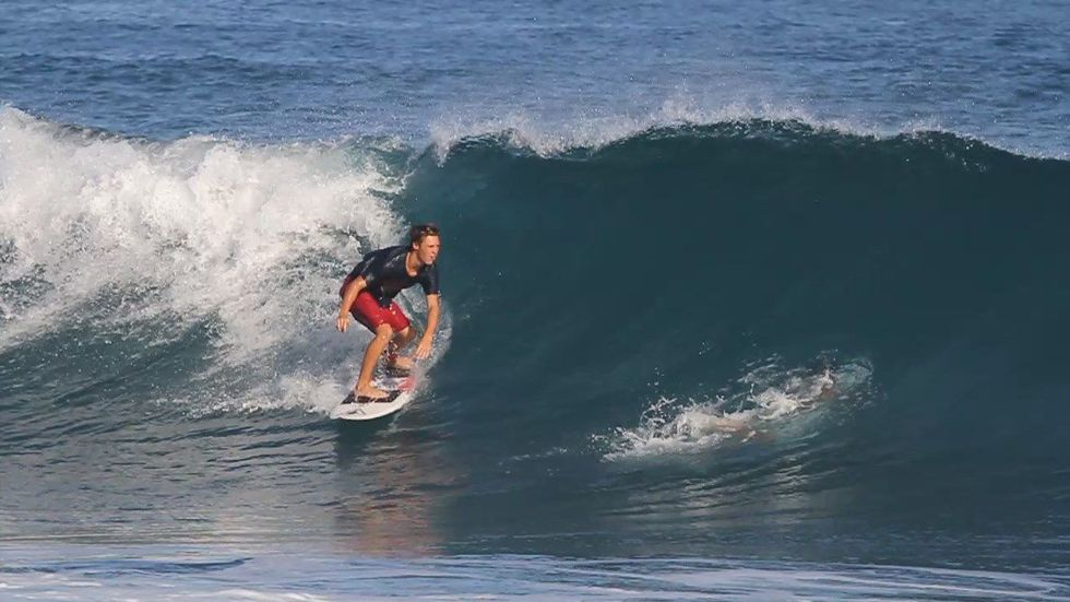 Surfer Micha Cantor rides a wave. (Source: Stoney Cantor)