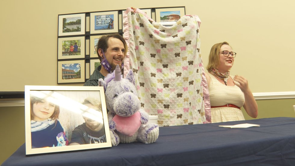 Chad Swetlik and Selena Collins hold a quilt honoring the life of their daughter, Faye Swetlik