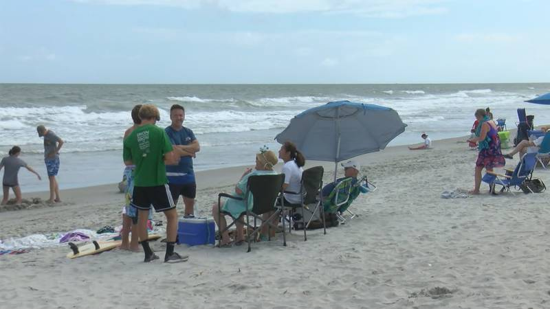 Family members say a 19-year-old will be fine after he was bitten by a shark while surfing in...
