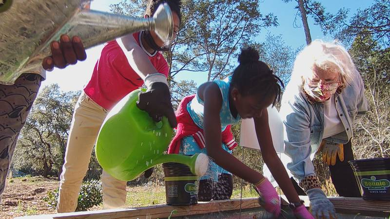 Kids work after school in the Pawleys Island Community Garden.
